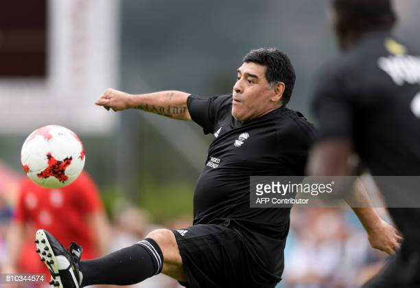 Former Argentinian football star Diego Maradona controls the ball during 'The Gianni's game the match of legends' a football match with football...