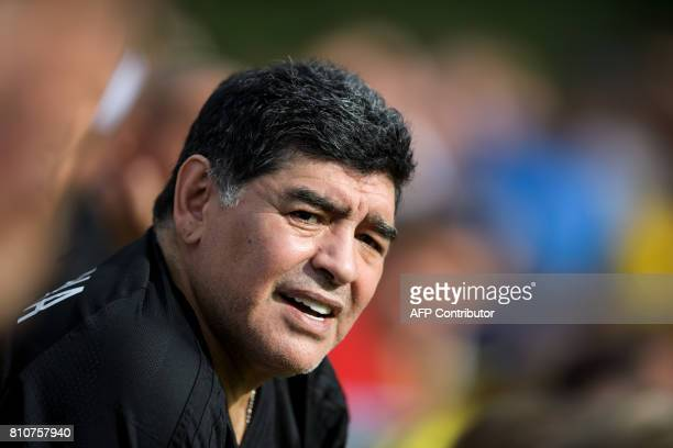 Former Argentinian football star Diego Maradona looks on during 'The Gianni's game the match of legends' a football match with football legends in...