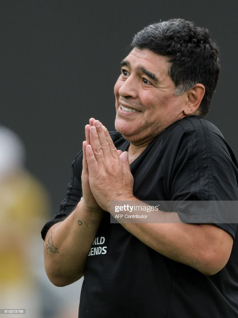 Former Argentinian football star Diego Maradona reacts during 'The Gianni's game, the match of legends', a football match with football legends in honour of FIFA's President on July 7, 2017 in Brig. / AFP PHOTO / Fabrice COFFRINI