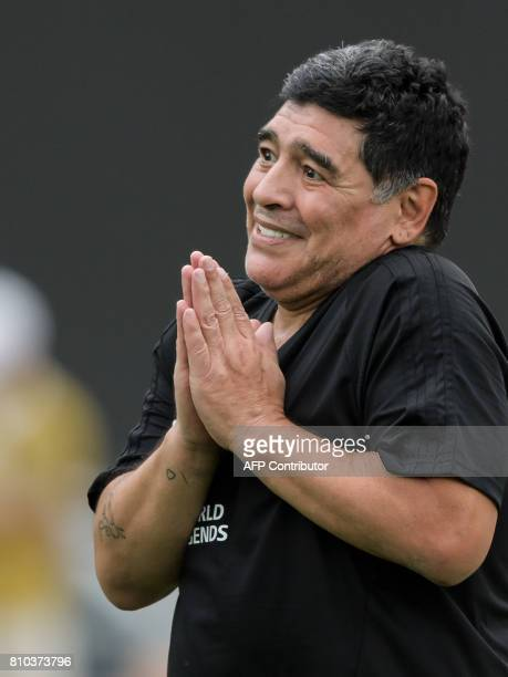 Former Argentinian football star Diego Maradona reacts during 'The Gianni's game the match of legends' a football match with football legends in...