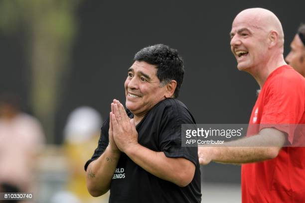 Former Argentinian football star Diego Maradona reacts next to FIFA President Gianni Infantino after scoring a goal during 'The Gianni's game the...