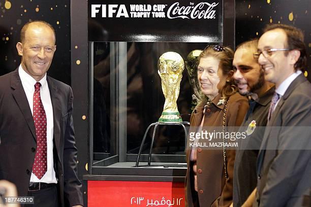 Former Argentinian footballer and international coach Gabriel Calder and Jordanian Prince Ali Bin alHussein FIFA vicepresident pose for a photograph...
