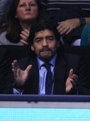 Former Argentinian footballer Diego Maradona applauds in the match between Novak Djokovic of Serbia and Tomas Berdych of Czech Republic during the...