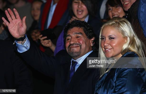 Former Argentinian footballer Diego Maradona waves with Veronica Ojeda in the match between Novak Djokovic of Serbia and Tomas Berdych of Czech...
