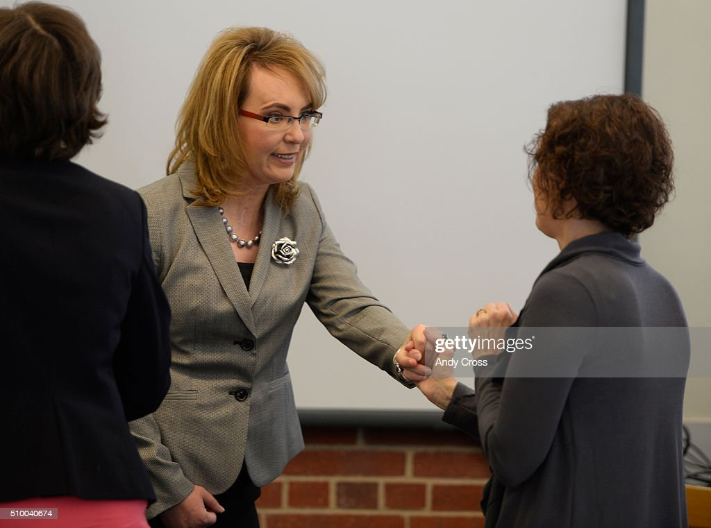 Former Arizona congresswoman Gabby Giffords greets Jane Dougherty at the start of a round table discussion at Manuel High School on efforts to reduce gun violence February 13, 2016. Giffords was gunned down in Arizona January 2011 while meeting with constituents at a super market leaving her with a long recovery and a brain injury. Six others were killed in the attack. Dougherty's sister Mary Sherlach was killed at Sandy Hook Elementary School in December 2012, 28 people including the shooter and his mother were shot and killed.
