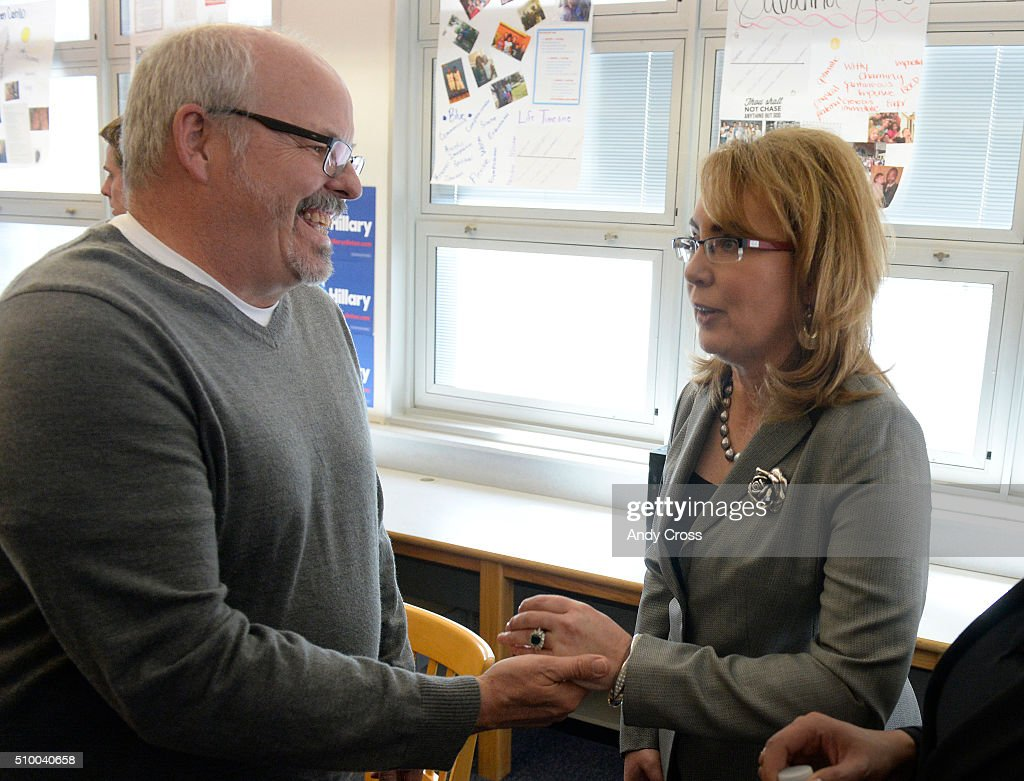 Former Arizona congresswoman Gabby Giffords greets Tom Sullivan after a round table discussion at Manuel High School on efforts to reduce gun violence February 13, 2016. Giffords was gunned down in Arizona January 2011 while meeting with constituents at a super market leaving her with a long recovery and a brain injury. Six others were killed in the attack. Tom Sullivan lost his son Alex in the July 2012 Aurora theater shooting, a total of 12 people were shot and killed that night and over 70 were injured.