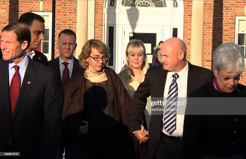 Former Arizona congresswoman Gabby Giffords leaves the Newtown Municipal Center in Newtown, Connecticut, on Friday, January 4, 2013, with her husband, Mark Kelly, Senator Richard Blumenthal, and Lt. Gov. Nancy Wyman. Giffords, who is still recovering from her 2010 shooting, met with families that were affected by the Sandy Hill shooting.