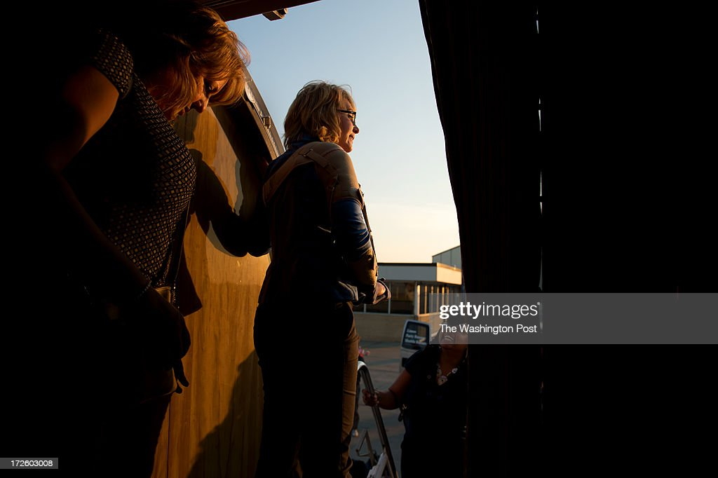 Former Arizona Congresswoman Gabrielle Giffords looks out from the plane as she arrives in Bismarck, North Dakota, from Alaska, during the Americans for Responsible Solutions tour, on Tuesday, July 2, 2013. Giffords and her husband Astronaut and Retired U.S. Navy Captain Mark Kelly are on a 7 state tour chatting with local residents about responsible gun legislation which includes background checks when buying a gun.