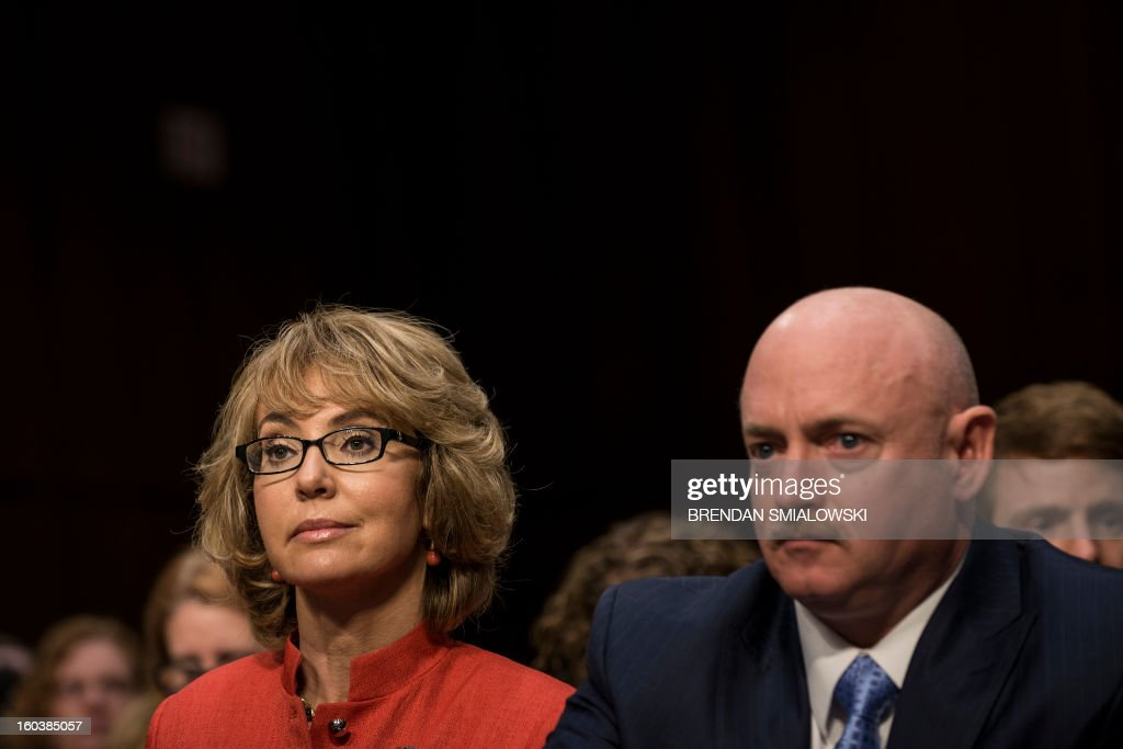 Former Arizona Rep. Gabrielle Giffords and her husband Retired Astronaut Mark Kelly wait to speak during a hearing of the Senate Judiciary Committee on Capitol Hill January 30, 2013 in Washington, DC. The committee held the hearings to hear possible solutions to gun violence in the United States. AFP PHOTO/Brendan SMIALOWSKI