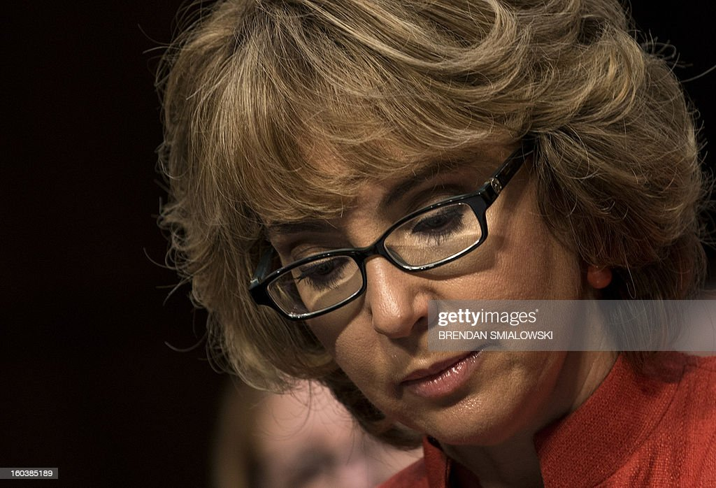 Former Arizona Rep. Gabrielle Giffords, pauses while speaking during a hearing of the Senate Judiciary Committee on Capitol Hill January 30, 2013 in Washington, DC. The committee held the hearings to discuss possible solutions to gun violence in the United States. AFP PHOTO/Brendan SMIALOWSKI