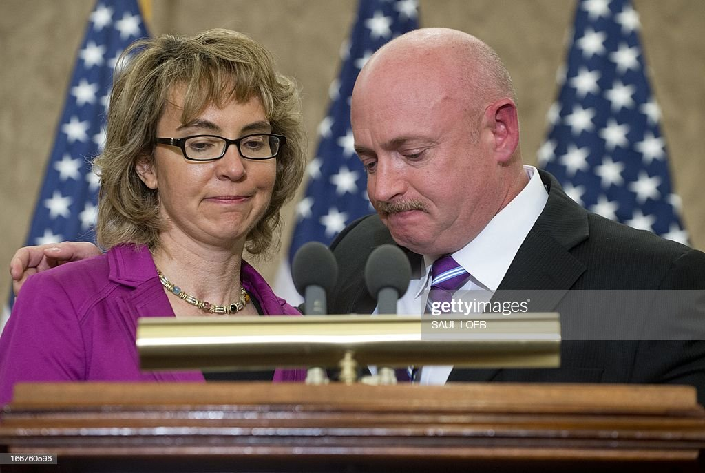Former Arizona Representative Gabrielle Giffords and her husband Mark Kelly attend a dedication ceremony naming a Capitol Visitor Center conference room in honor of slain Giffords' aide Gabe Zimmerman at the US Capitol in Washington on April 16, 2013. Zimmerman was killed in the January 2011 shooting that left 6 dead and Giffords severely wounded at an event in Tucson, Arizona. AFP PHOTO / Saul LOEB