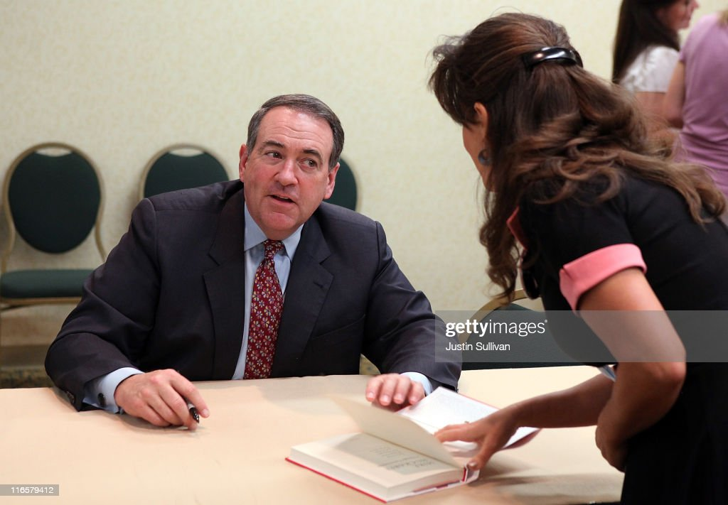 Former Arkansas governor and FOX new personality <a gi-track='captionPersonalityLinkClicked' href=/galleries/search?phrase=Mike+Huckabee&family=editorial&specificpeople=226521 ng-click='$event.stopPropagation()'>Mike Huckabee</a> signs copies of his book at the 2011 Republican Leadership Conference on June 16, 2011 in New Orleans, Louisiana. The 2011 Republican Leadership Conference runs through Saturday and will feature keynote addresses from all of the major republican candidates for president as well as numerous republican leaders from across the country.