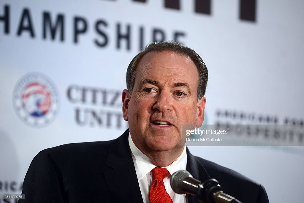 Former Arkansas Governor <a gi-track='captionPersonalityLinkClicked' href=/galleries/search?phrase=Mike+Huckabee&family=editorial&specificpeople=226521 ng-click='$event.stopPropagation()'>Mike Huckabee</a> speaks at the Freedom Summit at The Executive Court Banquet Facility April 12, 2014 in Manchester, New Hampshire. The Freedom Summit held its inaugural event where national conservative leaders bring together grassroots activists on the eve of tax day. Photo by Darren McCollester/Getty Images)