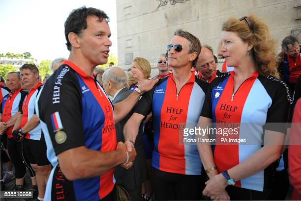 Former army captain Bryn Parry centre CEO and cofounder of Help for Heroes a charity for wounded servicemen and his wife Emma are congratulated by...