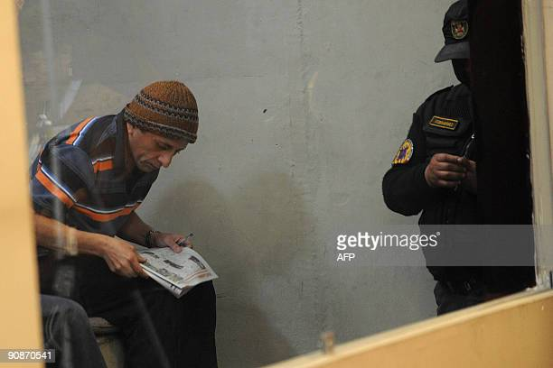Former Army Major Antauro Humala brother of Peruvian former presidential candidate Ollanta Humala resolves a crossword as he listens to his sentence...