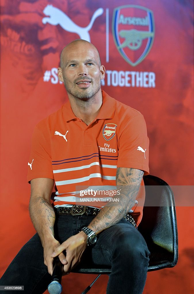 Former Arsenal footballer, Fredrick Ljungberg of Sweden takes part in an interactive session with fans during the launch of Arsenal Football Club kits in Bangalore on August 12, 2014. Fredrick, who is the brand ambassador for Arsenal Soccer Schools, launched sports brand Puma's Arsenal Home, Away And Cup Kits for 2014/15 football season in India. AFP PHOTO/Manjunath KIRAN