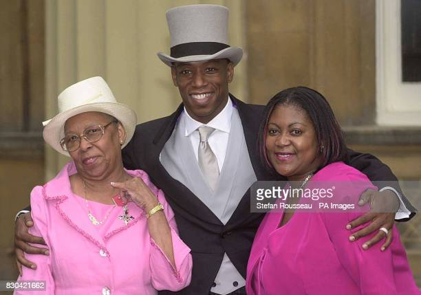 Former Arsenal footballer Ian Wright with his wife Debbie and mother Nesta after receiving an MBE from Queen Elizabeth II at Buckingham Palace in...