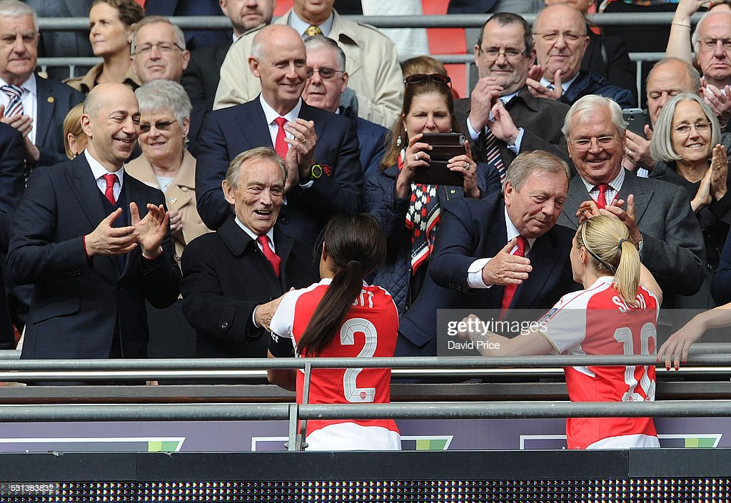 Former Arsenal Ladies Manager Vic Akers hugs Kelly Smith of Arsenal Ladies as Arsenal Director Ken Friar shakes hands with Alex Scott as Arsenal...