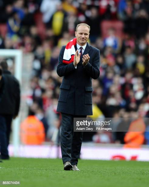 Former Arsenal player Dennis Bergkamp is introduced to the crowd during the Barclays Premier League match at the Emirates Stadium London