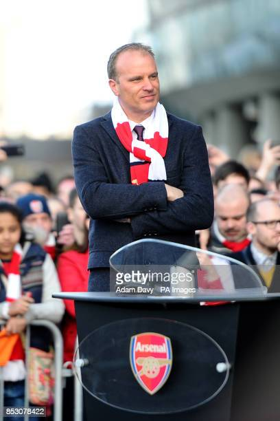 Former Arsenal player Dennis Bergkamp waits to unveil a statue of himself before the Barclays Premier League match at the Emirates Stadium London