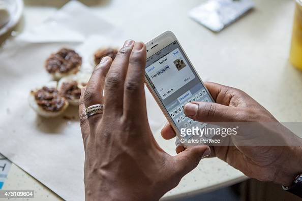 Former Arsenal player Ian Wright tweets about his food at a breakfast with bloggers at Tiong Bahru market during day 2 of the Barclays Asia Trophy...