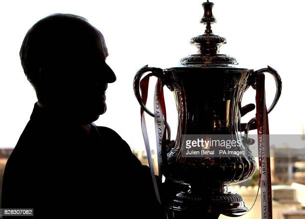 Former Arsenal player Liam Brady poses with the FA Cup during a photocall at the Conrad Hotel Dublin Wednesday January 25 2006 Irish footballing...