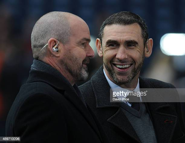 Former Arsenal player Martin Keown chats to Steve Clarke former WBA Manager before the match between West Bromwich Albion and Arsenal in the Barclays...