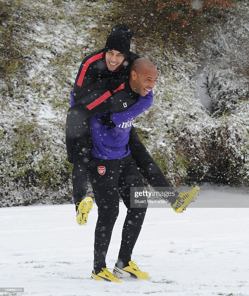 Former Arsenal player <a gi-track='captionPersonalityLinkClicked' href=/galleries/search?phrase=Thierry+Henry&family=editorial&specificpeople=167275 ng-click='$event.stopPropagation()'>Thierry Henry</a> laughs with Andre Santos of Arsenal before a training session at London Colney on January 18, 2013 in St Albans, England.