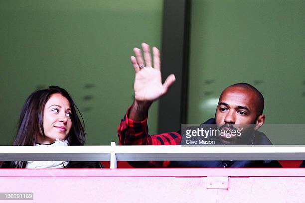 Former Arsenal player Thierry Henry of the New York Red Bulls is seen in the grandstand during the Barclays Premier League match between Arsenal and...