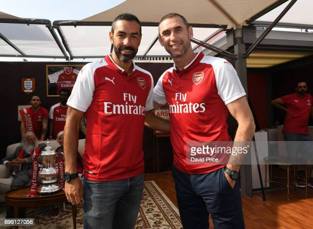 Former Arsenal players Robert Pires and Martin Keown on stage to help introduce the new Arsenal Puma Home kit at King's Cross St Pancras Station on...