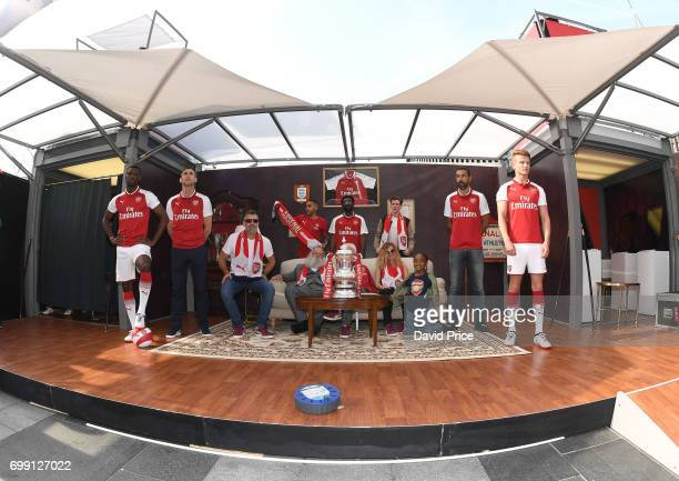 Former Arsenal players Robert Pires and Martin Keown stand on stage to help introduce the new Arsenal Puma Home kit at King's Cross St Pancras...