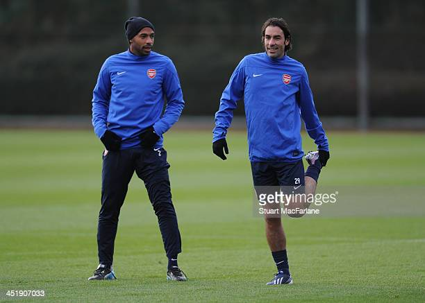 Former arsenal players Thierry Henry and Robert Pires train with the Arsenal squad during a training session at London Colney on November 25 2013 in...