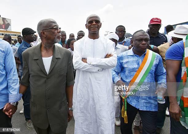 Former Assembly president and Liberte et democratie pour la Republique party's leader Mamadou Coulibaly flanked by Parti pour le Progres et le...