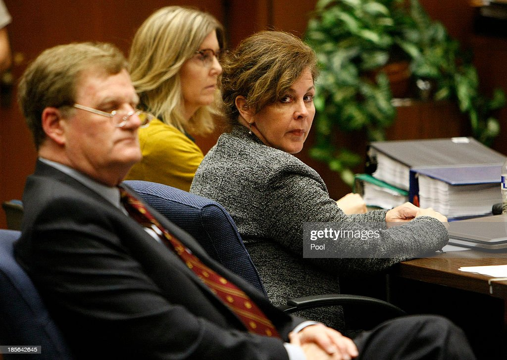 Former assistant city manager of Bell, Angela Spaccia (C) who is charged with misappropriation of public funds and other counts, listens to opening statements in Los Angeles Superior Court October 23, 2013 in Los Angeles, California. Spaccia, who is facing 13 corruption-related felony counts, is expected to testify in the municipal corruption case.