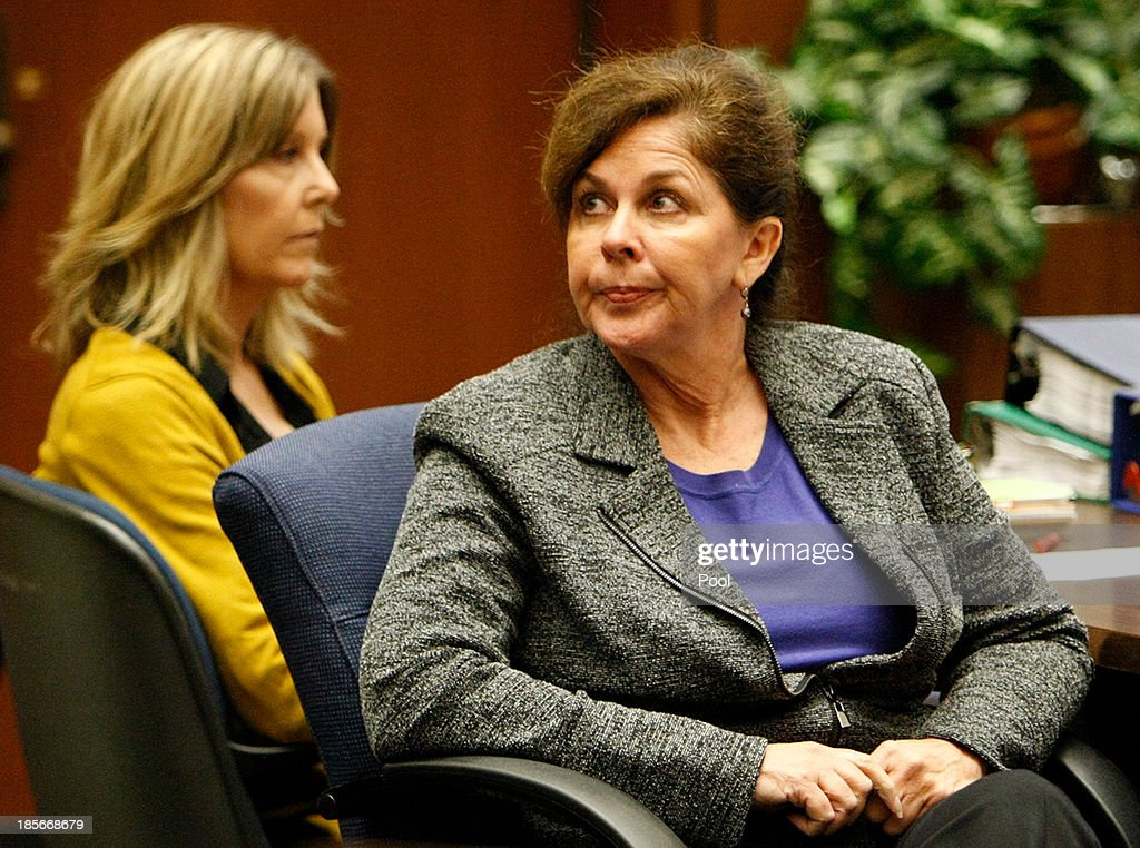 Former assistant city manager of Bell, Angela Spaccia, who is charged with misappropriation of public funds and other counts, listens to opening statements in Los Angeles Superior Court on October 23, 2013 in Los Angeles, California. Spaccia, who is facing 13 corruption-related felony counts, is expected to testify in the municipal corruption case.
