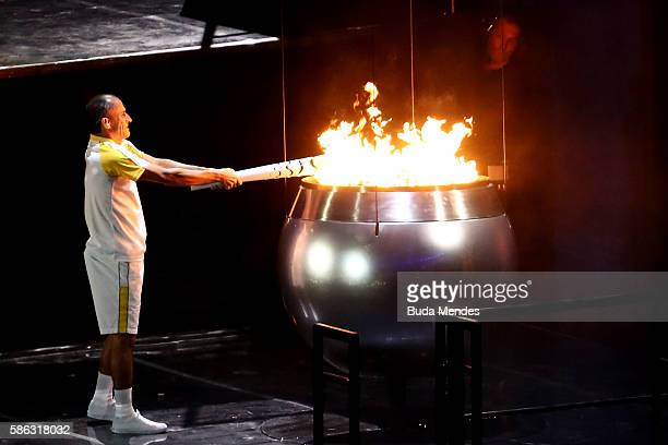 Former athlete Vanderlei de Lima lights the Olympic Cauldron during the Opening Ceremony of the Rio 2016 Olympic Games at Maracana Stadium on August...