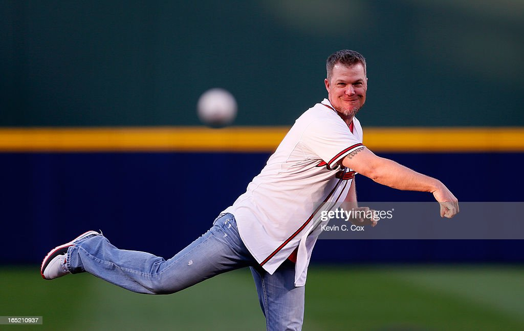 Former Atlanta Brave <a gi-track='captionPersonalityLinkClicked' href=/galleries/search?phrase=Chipper+Jones&family=editorial&specificpeople=171256 ng-click='$event.stopPropagation()'>Chipper Jones</a> throws out the ceremonial first pitch prior to the game against the Philadelphia Phillies during Opening Day at Turner Field on April 1, 2013 in Atlanta, Georgia.