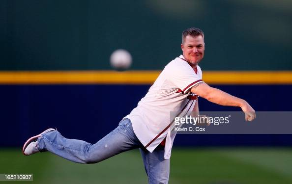 Former Atlanta Brave Chipper Jones throws out the ceremonial first pitch prior to the game against the Philadelphia Phillies during Opening Day at...