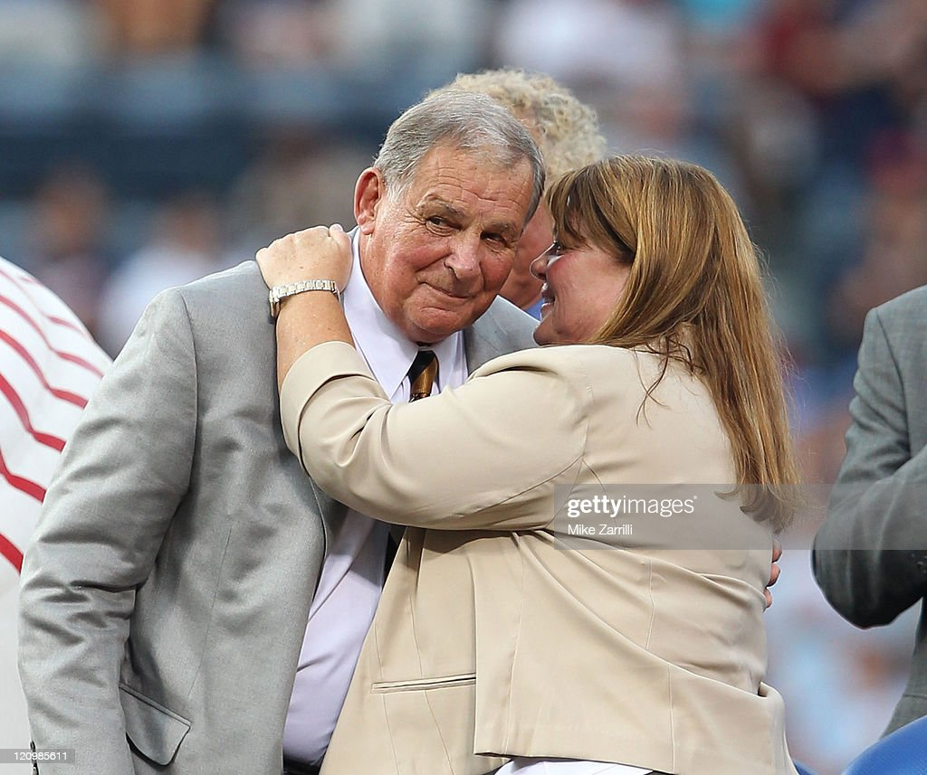 Former Atlanta Braves manager Bobby Cox hugs his wife Pam his number retirement ceremony before the game between the Atlanta Braves and the Chicago Cubs at Turner Field on August 12, 2011 in Atlanta, Georgia.