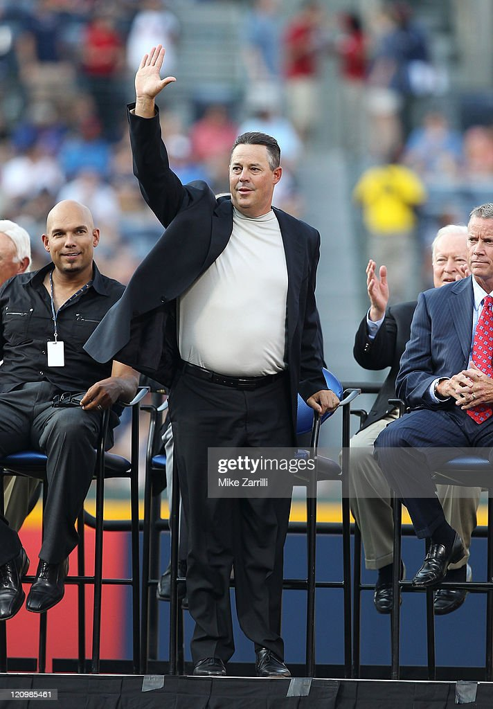 Former Atlanta Braves pitcher Greg Maddux acknowledges the crowd during the Bobby Cox number retirement ceremony before the game between the Atlanta Braves and the Chicago Cubs at Turner Field on August 12, 2011 in Atlanta, Georgia.