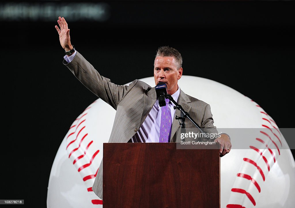 Former Atlanta Braves pitcher <a gi-track='captionPersonalityLinkClicked' href=/galleries/search?phrase=Tom+Glavine&family=editorial&specificpeople=202817 ng-click='$event.stopPropagation()'>Tom Glavine</a> acknowledges the crowd during a ceremony in which the Braves retired his jersey number 47 before the game against the San Francisco Giants at Turner Field on August 6, 2010 in Atlanta, Georgia. The Giants defeated the Braves 3-2.