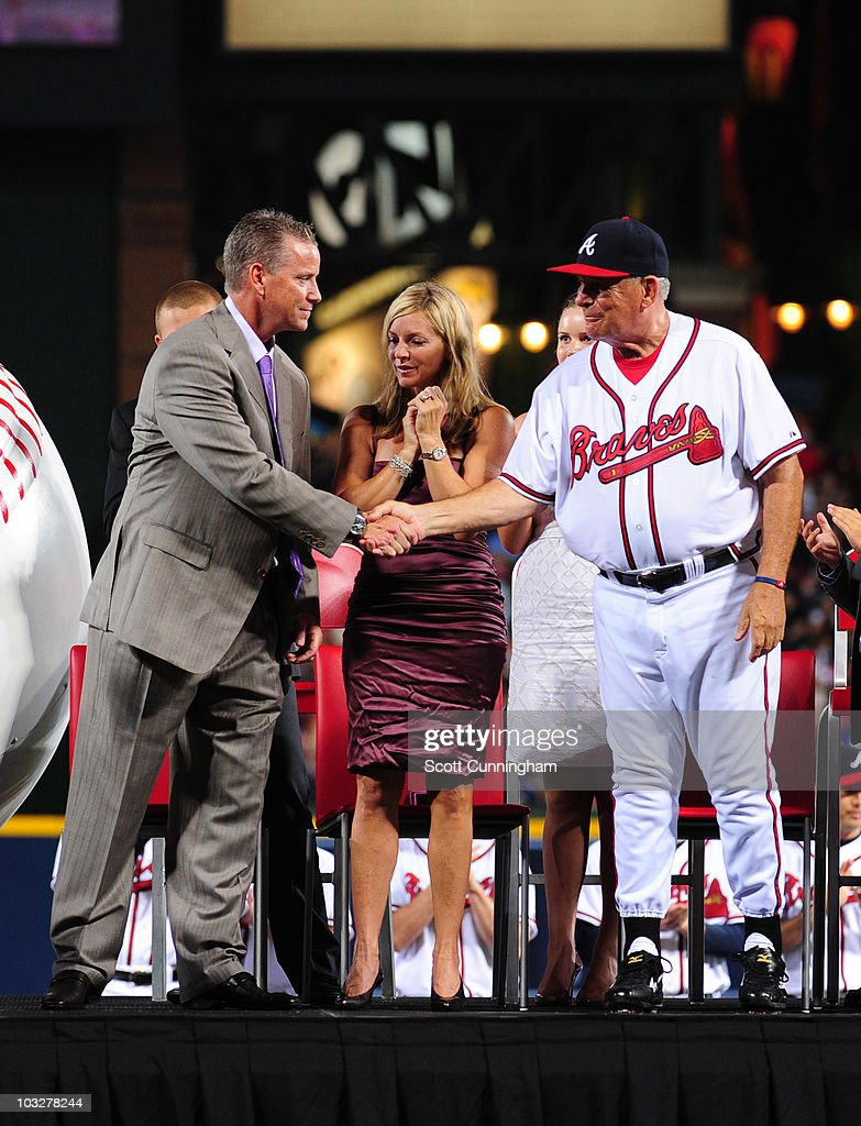 Former Atlanta Braves pitcher <a gi-track='captionPersonalityLinkClicked' href=/galleries/search?phrase=Tom+Glavine&family=editorial&specificpeople=202817 ng-click='$event.stopPropagation()'>Tom Glavine</a> is congratulated by Manager <a gi-track='captionPersonalityLinkClicked' href=/galleries/search?phrase=Bobby+Cox&family=editorial&specificpeople=208630 ng-click='$event.stopPropagation()'>Bobby Cox</a> during a ceremony in which the Braves retired his jersey number 47 before the game against the San Francisco Giants at Turner Field on August 6, 2010 in Atlanta, Georgia. The Giants defeated the Braves 3-2.