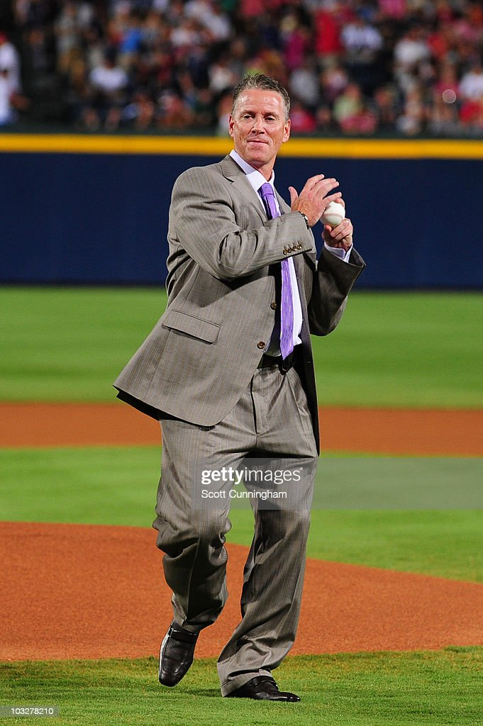 Former Atlanta Braves pitcher <a gi-track='captionPersonalityLinkClicked' href=/galleries/search?phrase=Tom+Glavine&family=editorial&specificpeople=202817 ng-click='$event.stopPropagation()'>Tom Glavine</a> throws out the first pitch before the game against the San Francisco Giants at Turner Field on August 6, 2010 in Atlanta, Georgia. The Giants defeated the Braves 3-2.