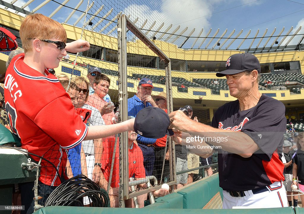 Former Atlanta Braves player <a gi-track='captionPersonalityLinkClicked' href=/galleries/search?phrase=Dale+Murphy&family=editorial&specificpeople=210608 ng-click='$event.stopPropagation()'>Dale Murphy</a> signs an autograph for a fan before the spring training game against the Detroit Tigers at Champion Stadium on February 22, 2013 in Lake Buena Vista, Florida. The Tigers defeated the Braves 2-1.