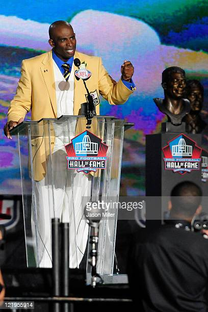 Former Atlanta Falcons cornerback Deion Sanders talks to the fans after he unveiled his bust at the Enshrinement Ceremony for the Pro Football Hall...