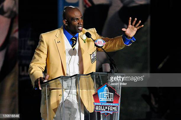 Former Atlanta Falcons cornerback Deion Sanders talks to the fans after unveiling his bust at the Enshrinement Ceremony for the Pro Football Hall of...