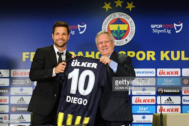 Former Atletico Madrid's Brazilian midfielder Diego Ribas holding his new club's jersey and Fenerbahce Football Club's President Aziz Yildirim pose...