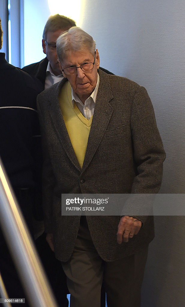 Former Auschwitz guard Reinhold Hanning arrives for his trial at court in Detmold, western Germany, on February 11, 2016. The 94-year-old man is charged with at least 170,000 counts of accessory to murder in his role as a former guard at the Nazi concentration camp in occupied Poland. / AFP / PATRIK STOLLARZ