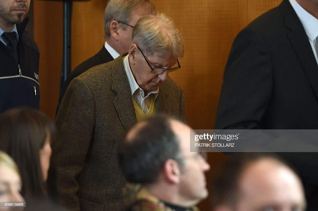 Former Auschwitz guard Reinhold Hanning (C) arrives for his trial at court in Detmold, western Germany, on February 11, 2016. The 94-year-old man is charged with at least 170,000 counts of accessory to murder in his role as a former guard at the Nazi concentration camp in occupied Poland. / AFP / PATRIK STOLLARZ