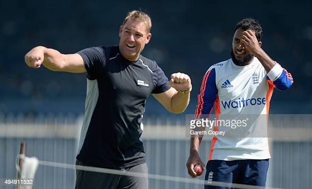 Former Australia bowler Shane Warne coaches Adil Rashid of England during a nets session at Sharjah Cricket Stadium on October 30 2015 in Sharjah...